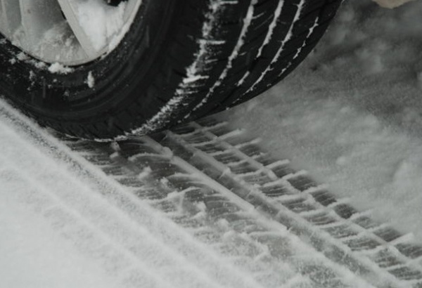 car tire snow winter weather driving generic