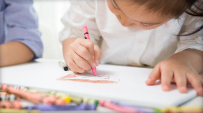 Children drawing with crayon_25238