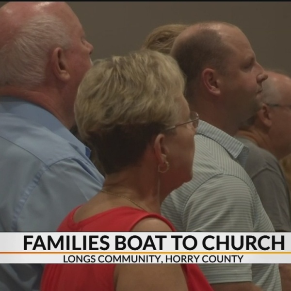 Families_boat_to_church_0_20180924095401