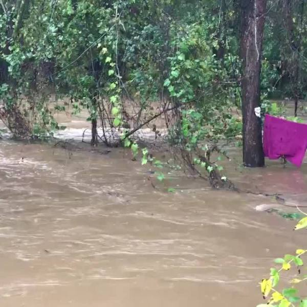 Asheville Fire Dept. rescue people trapped in hammock by flooding