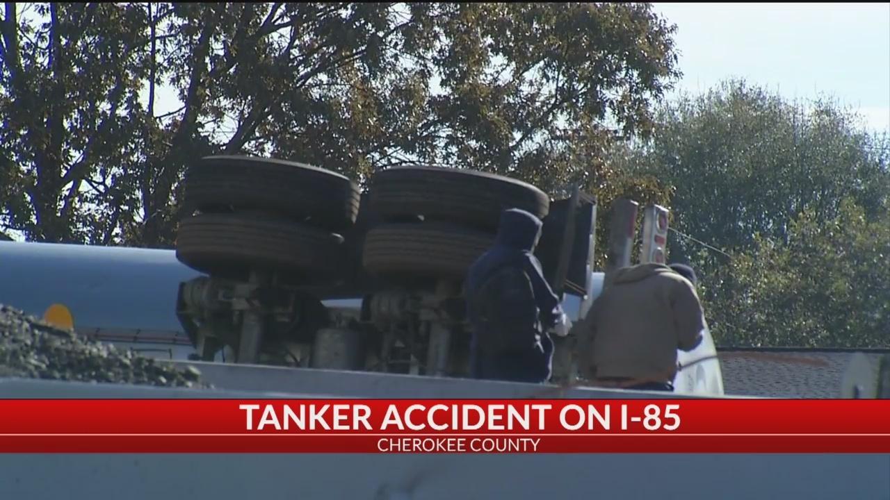 I-85N shutdown due to overturned big rig in Cherokee Co