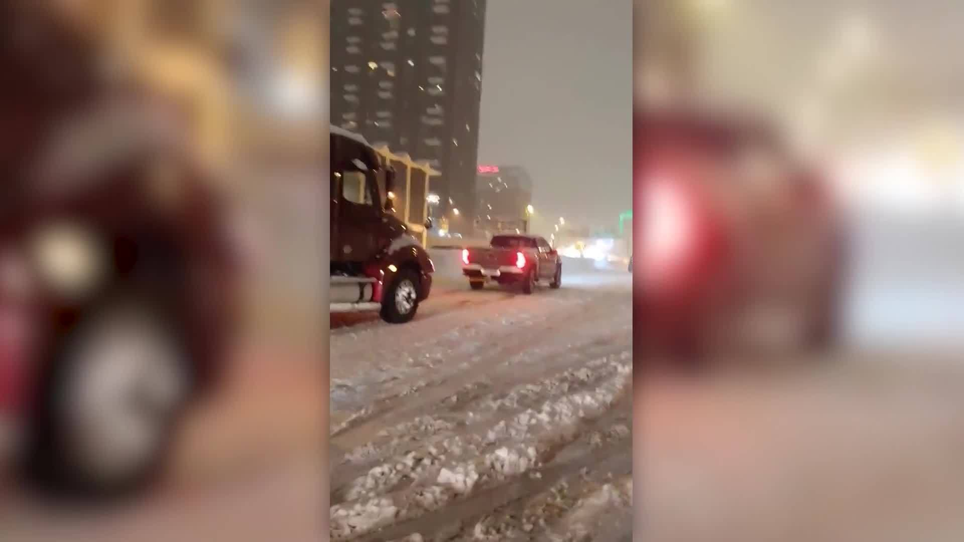 VIDEO: Pickup truck pulls semi up icy highway