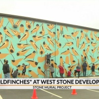 Joseph Bradley and local 5th graders paint 88 foot mural on Stone Ave.