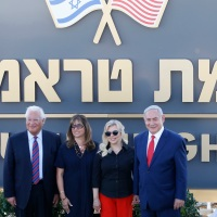 Israeli Prime Minister Benjamin Netanyahu, right, his wife Sara , United States Ambassador to Israel David Friedman, left, his wife Tammy pose during the inauguration of a new settlement named after President Donald Trump in the Golan Heights, Sunday, June 16, 2019.