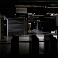 Hallways of Buenos Aires's subway are lit only by emergency lights during a blackout, in Buenos Aires, Argentina, Sunday, June 16, 2019.