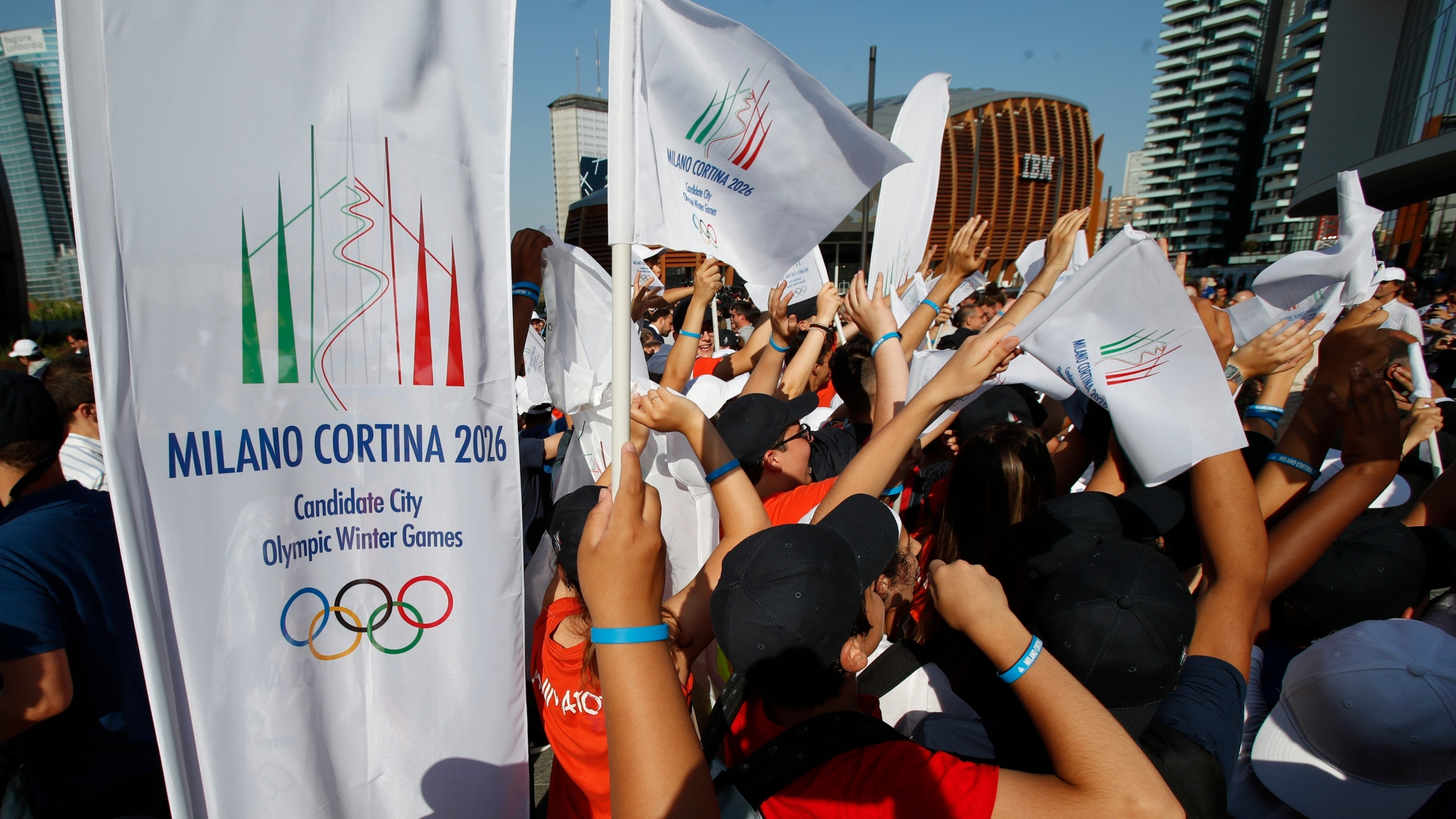 People celebrate after the announcement that the Italian bid of Milan-Cortina was voted by IOC members to host 2026 Winter Olympics, in Milan, Italy, Monday, June 24, 2019.