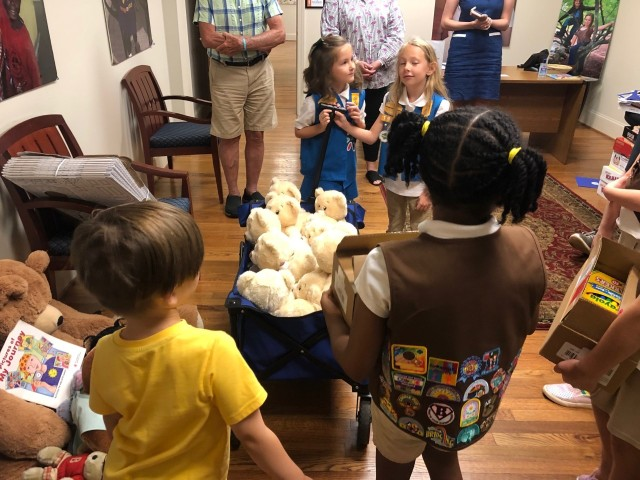 Girl Scout troop gifts teddy bears to children with cancer