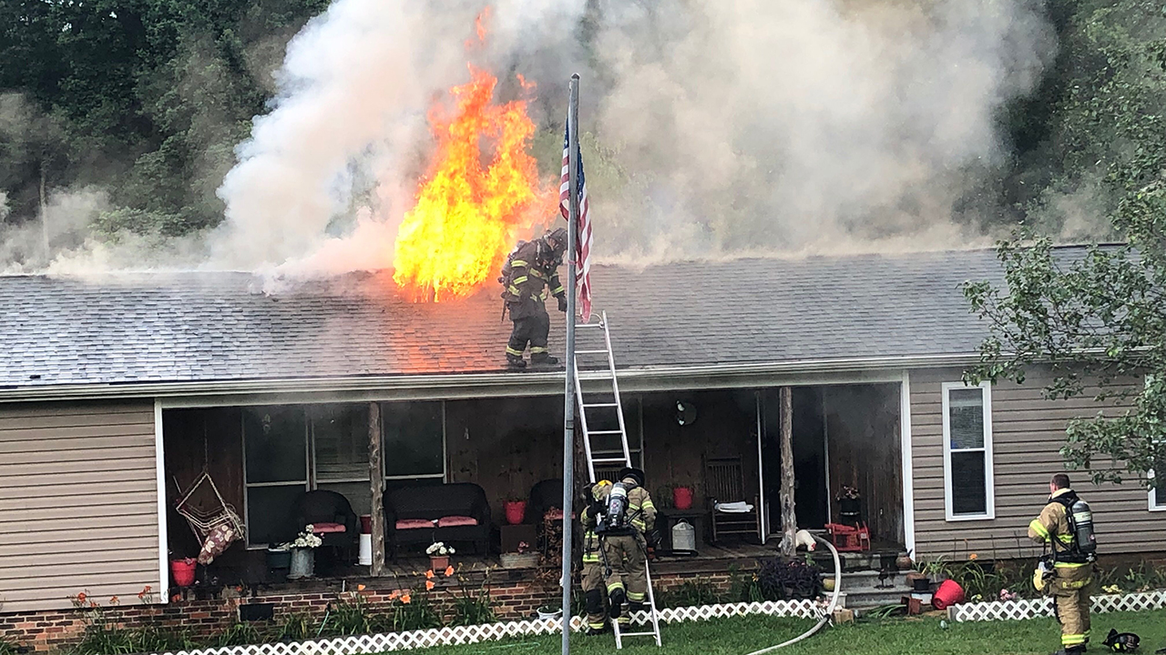 Firefighters at scene of house fire on K & M Farm Road in Anderson County, Wednesday, July 3, 2019