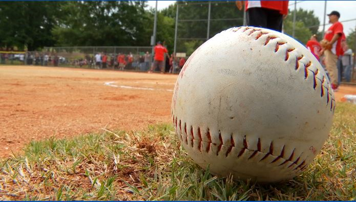 Hells Angels play softball for local charity during summer rally