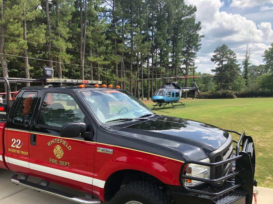 Helicopter lands to take away injured victim after crash on Old Williamston Rd. in Anderson County, Saturday, July 6, 2019.