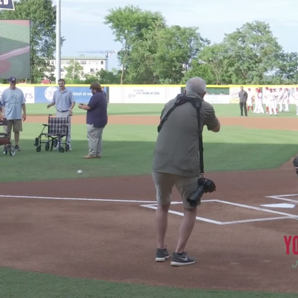 101-year-old throws first pitch at Fluor Field
