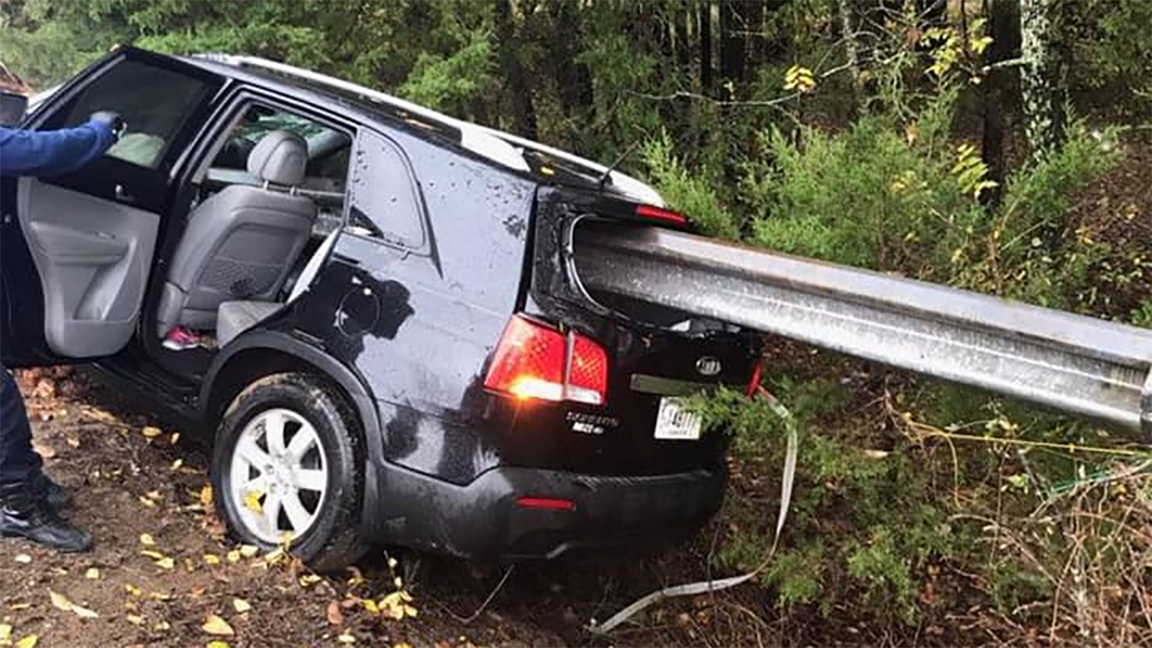 Car-impaled-on-guardrail.jpg