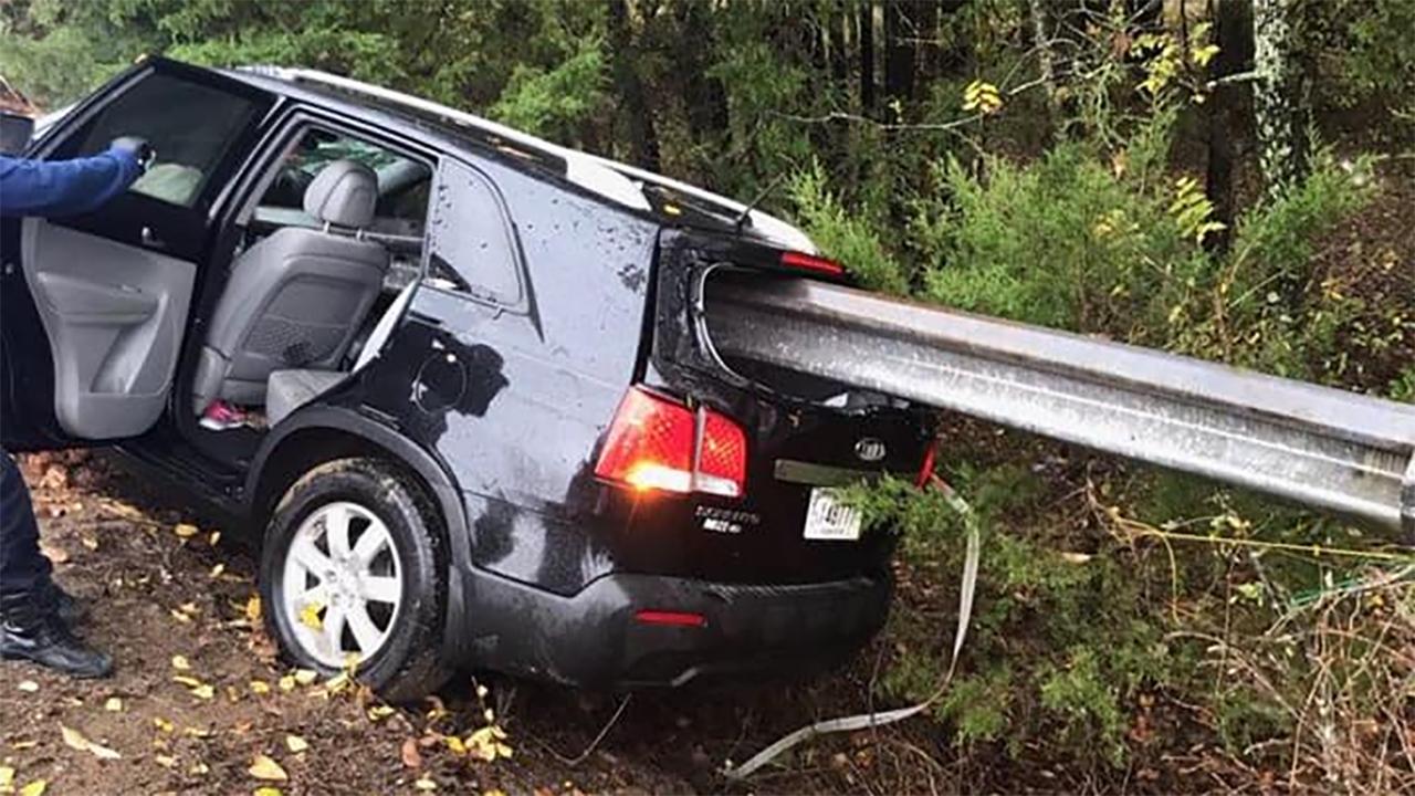 Car-impaled-on-guardrail.jpg