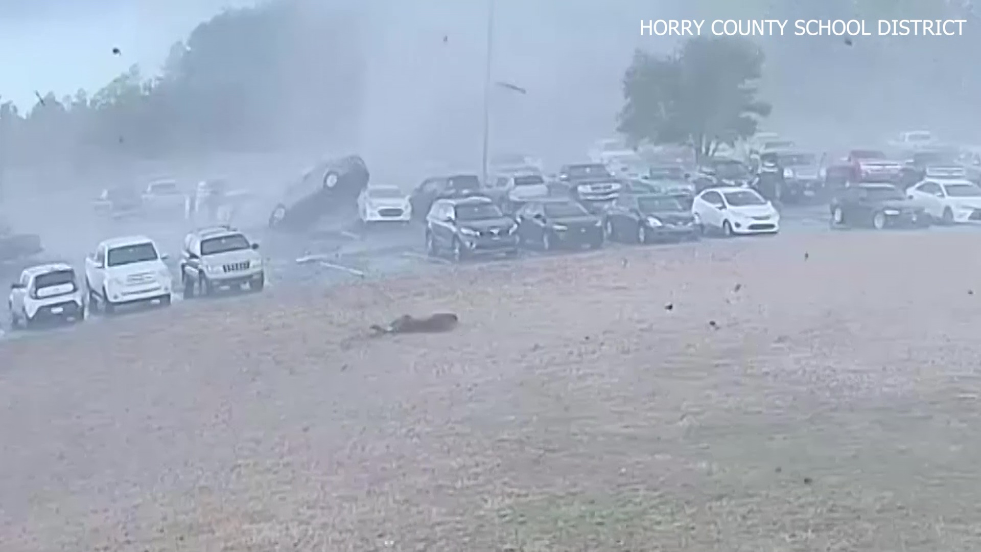 CAUGHT ON CAMERA: Tornado flips cars at South Carolina high school