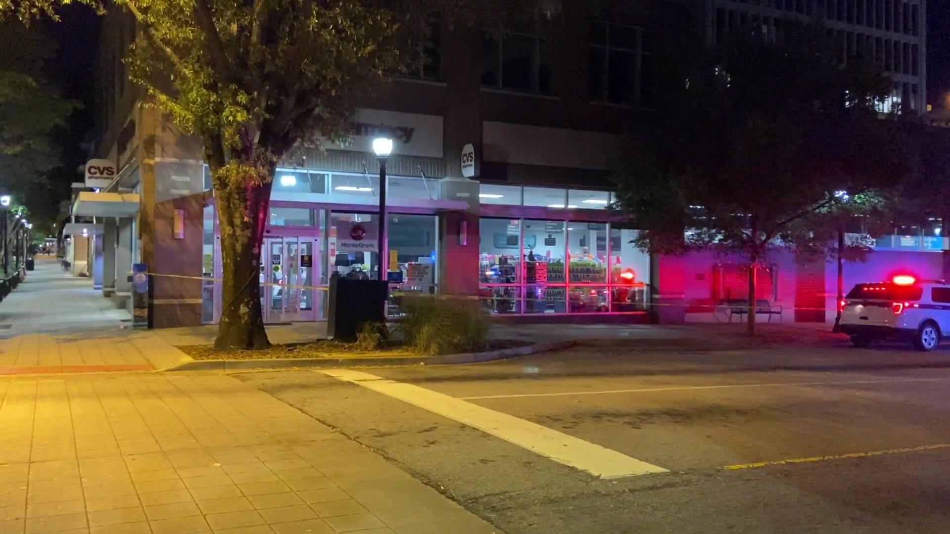 Police at scene of reported stabbing outside a CVS store at the corner of Main Street and McBee Avenue in downtown Greenville, October 1, 2020. (WSPA Photo)
